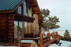 Hend chink style log Laramie Wyoming custom home builder handcrafted details (4) - Deerwood Log Homes - Custom Built Homes and Cabins - Laramie, Wyoming and The Centennial Valley - deer-wood.com - (307) 742-6554