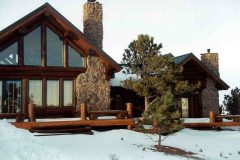 Hend chink style log Laramie Wyoming custom home builder handcrafted details (5) - Deerwood Log Homes - Custom Built Homes and Cabins - Laramie, Wyoming and The Centennial Valley - deer-wood.com - (307) 742-6554